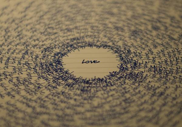 Image of the word 'love' surrounded by the word 'hate'