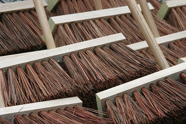 An image of some brooms