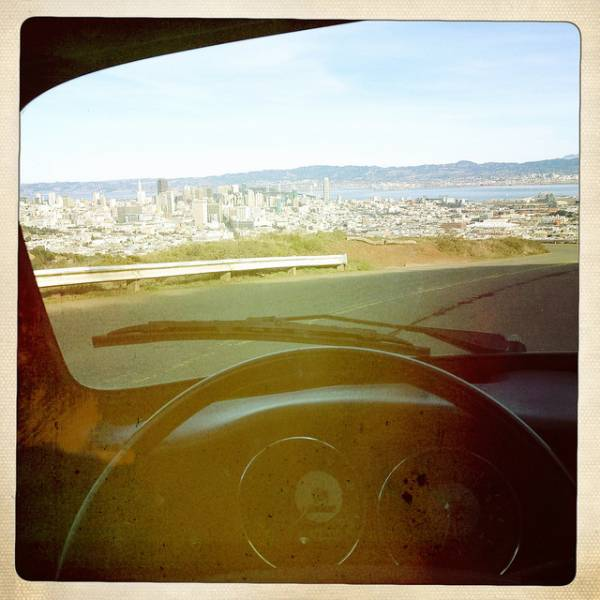 An image of San Francisco through the windshield of a car.