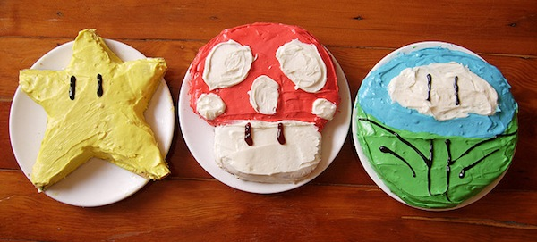 Image of three cakes shaped into Mario items.