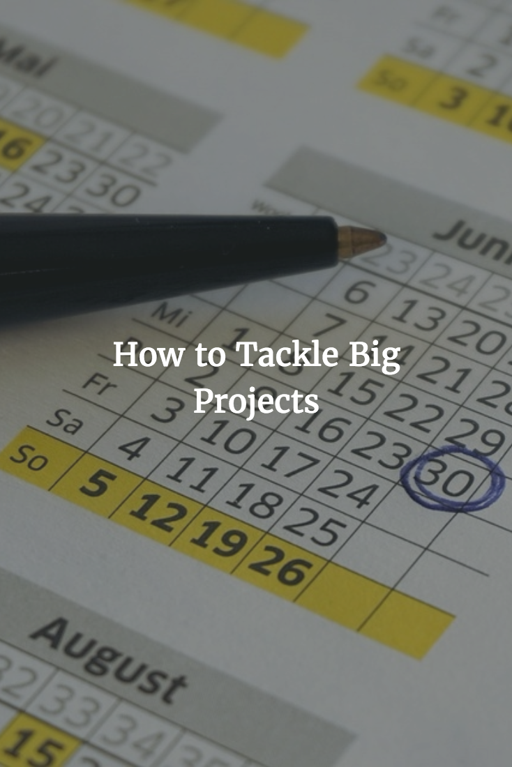 "A pen and planner with text that says ""How to tackle big projects"""